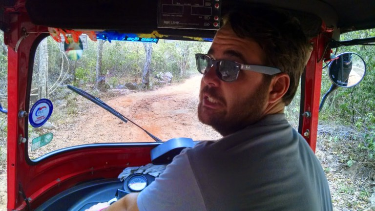 Christian driving a tuk tuk in Sri Lanka.