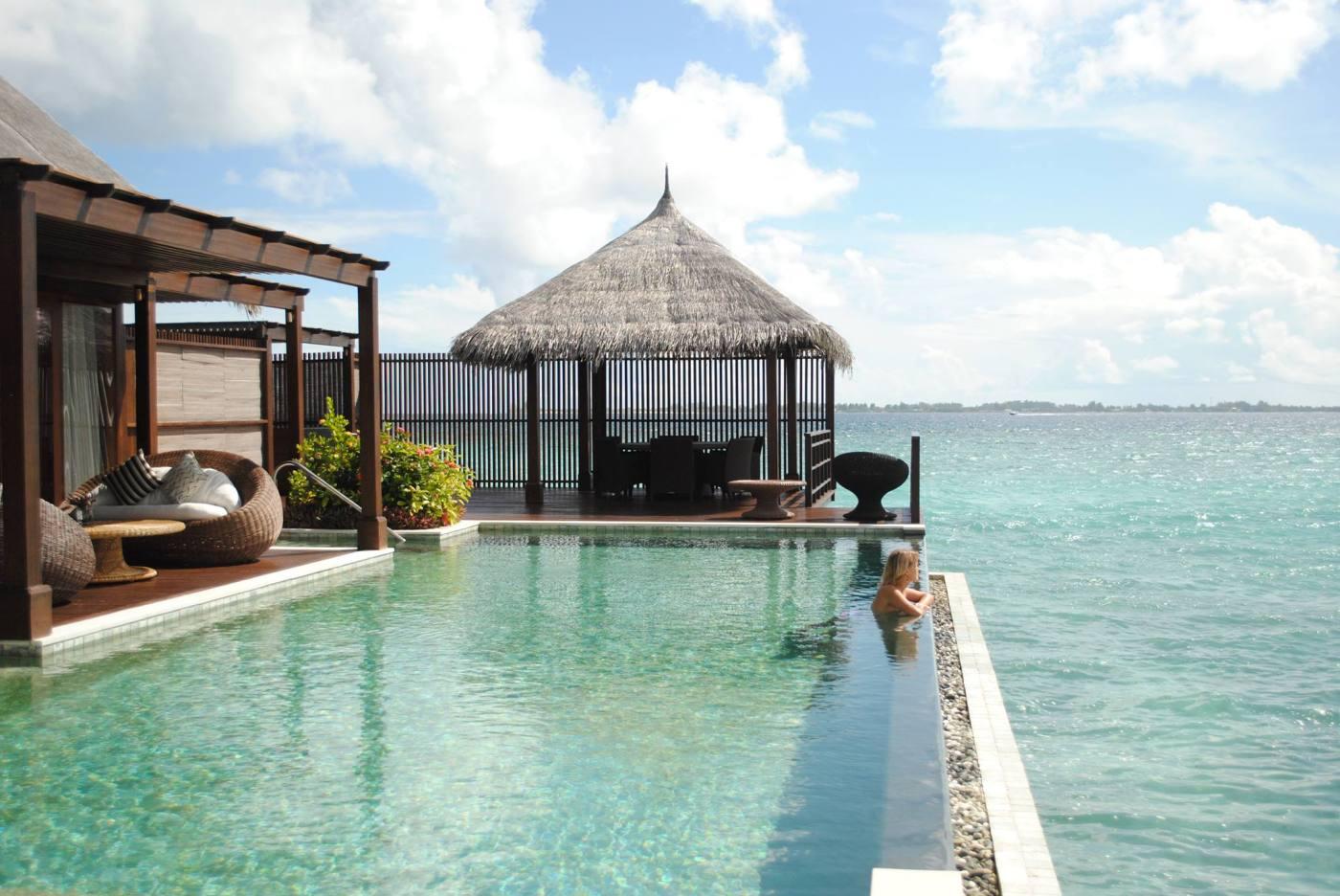 Sanne relaxing in a pool