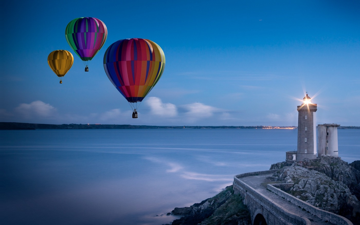Balloons taking off from coastline. A symbol of breaking free.